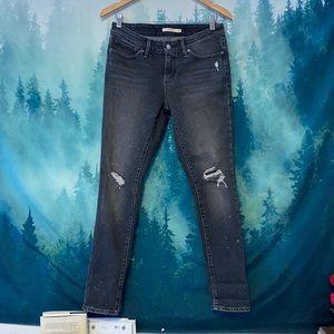 Levi's 711 black distressed skinny jeans